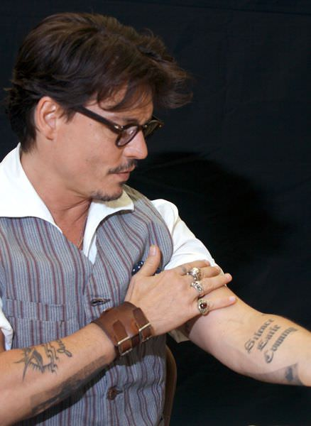 JOHNNY-DEPP-Press-Conferences-Pirates-of-the-Caribbean-4-Los-Angeles-04-05-2011-johnny-depp-21881301-1494-2048.jpg